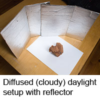 Photographing on white paper background in daylight with reflector