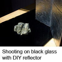 Diopside on black glass background with DIY reflector used to avoid deep shadows