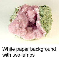 Cobaltocalcite on white paper background photographed with two lamps